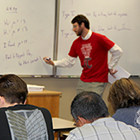 math instructor lecturing in a classroom (Source: CTC)